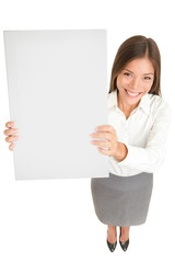 Businesswoman holding up a blank sign