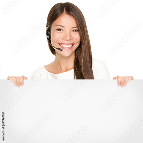 Beautiful Asian woman holding a blank sign