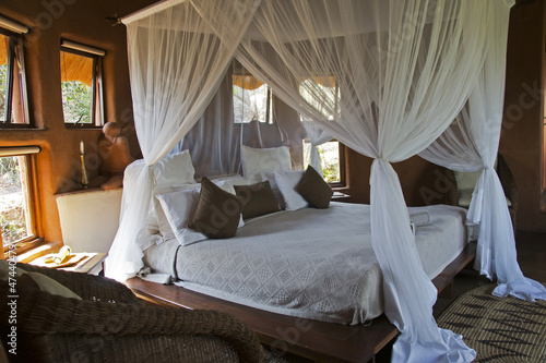 Leinwandbild Motiv Four-poster bed in an African lodge