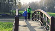 Couple jogging in park, crane shot, super slow motion