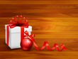Holiday background with gift box and red ball. Vector illustrati
