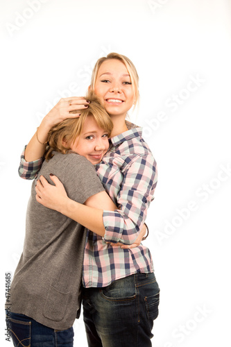 Happy young friends giving each other a hug