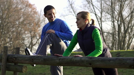 Young happy couple exercising outdoors