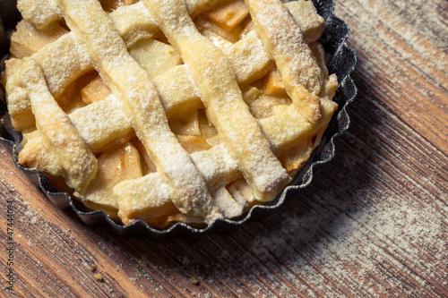 Closeup of a small plaque baked apple pie