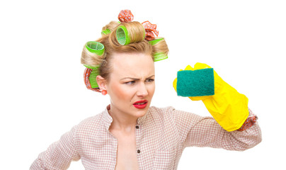Funny young housewife with gloves holding scrubber