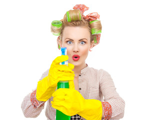 Funny housewife / woman spraying the cleaner on you