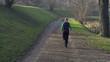 Woman jogging in park, crane shot