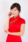 A wear qipao Asian woman, on the phone