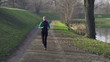 Woman jogging in park, crane shot, super slow motion