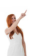 Beautiful redhead woman pointing her finger