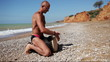 Djembe traditional Drum Player beat rythm on the lonely beach