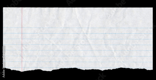 Torn white lined paper page top isolated on black.