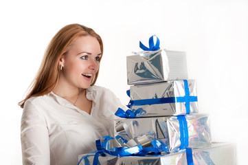 The girl with a gift on a light background