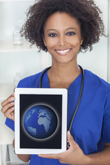 African American Female Doctor Tablet Computer World Map