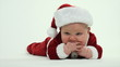 Cute 7-month-old baby boy in red Santa Claus outfit