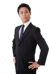 young businessman thinking by placing a hand on the waist