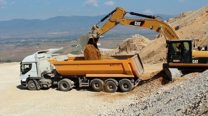 excavator and dumper truck  editorial