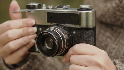 Old camera in the women's hands