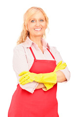 A female worker with apron wearing gloves and posing