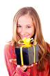 Sweet young girl with christmas presents