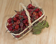 dried rosehip berries in wicker basket, close-up