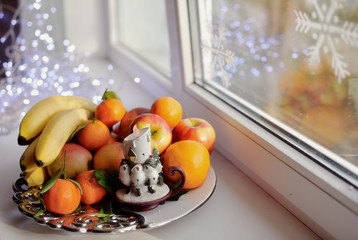 on the window still life fruit on a platter with a candle