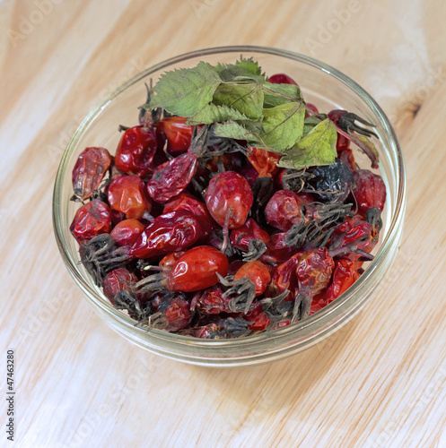 dried rosehip berries in glass bowl, close-up