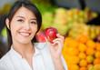 Woman buying organic