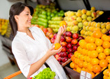 Woman buying fresh fruit
