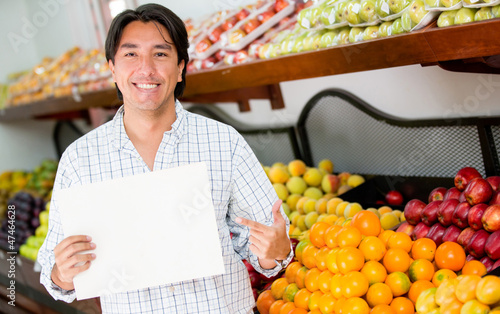 Man with an open sign at his business