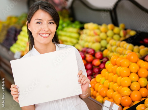 Female holding a banner at the supermarket
