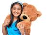 cute little girl embracing teddy bear