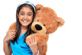 cute little girl embracing teddy bear