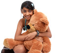 Pretty Indian girl embracing teddy bear