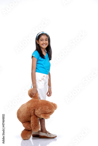 Portrait of young girl with her teddy bear
