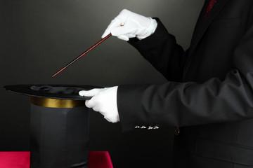 magician performance on dark background