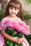 little girl posing with large bouquet of flowers