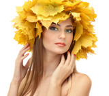 beautiful young woman with yellow autumn wreath, isolated