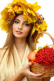 beautiful woman with wreath and basket with apples and berries,
