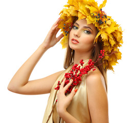 beautiful young woman with yellow autumn wreath and red