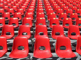 Red chairs of empty stadium but ready to accommodate the fans poster