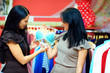 beautiful women buying bra in lingerie shop