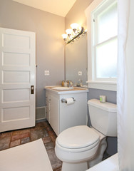 GREY and white small bathroom.