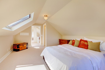 Bright clean attic bedroom  in the small home.