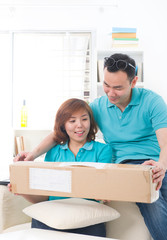 asian couple doing online shopping