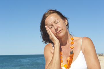 Senior woman headache menopause