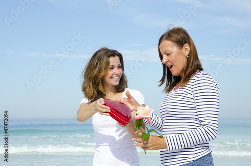 Mother and daughter  flower and red heart gift box