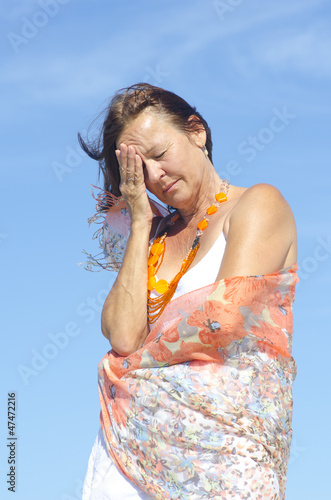 Senior woman migraine headache menopause