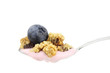 Spoonful of yogurt, muesli and blueberry isolated on white