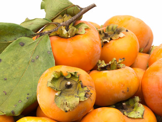 pile of orange persimmons isolated on white background